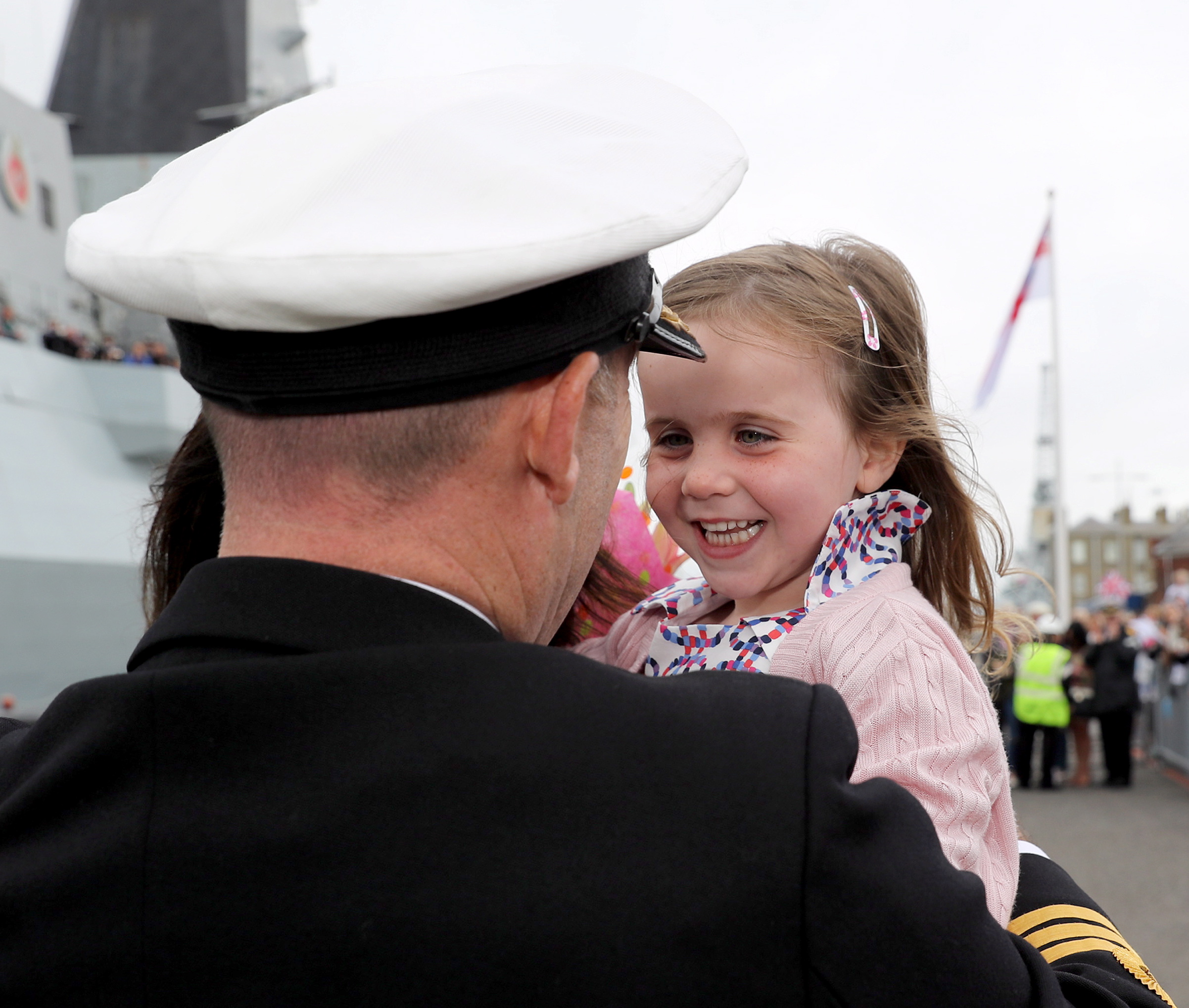 HMS DEFENDER RETURNS HOME  Georginna Higham welcomes home her father the CO of HMS Defender Cdr Stephen Higham.  Portsmouth-based warship HMS Defender returned home today (July 8) from a nine month deployment to the middle east carrying out security operations.  The Band of Her Majesty's Royal Marines Portsmouth performed on the jetty as the crowds eagerly awaitied the return of sailors on board.  Hundreds of proud family and friends waved and cheered as the ship came alongside, clearly delighted to welcome their loved ones home.  Image: LPhot Kyle Heller Consent held at FRPU(E)