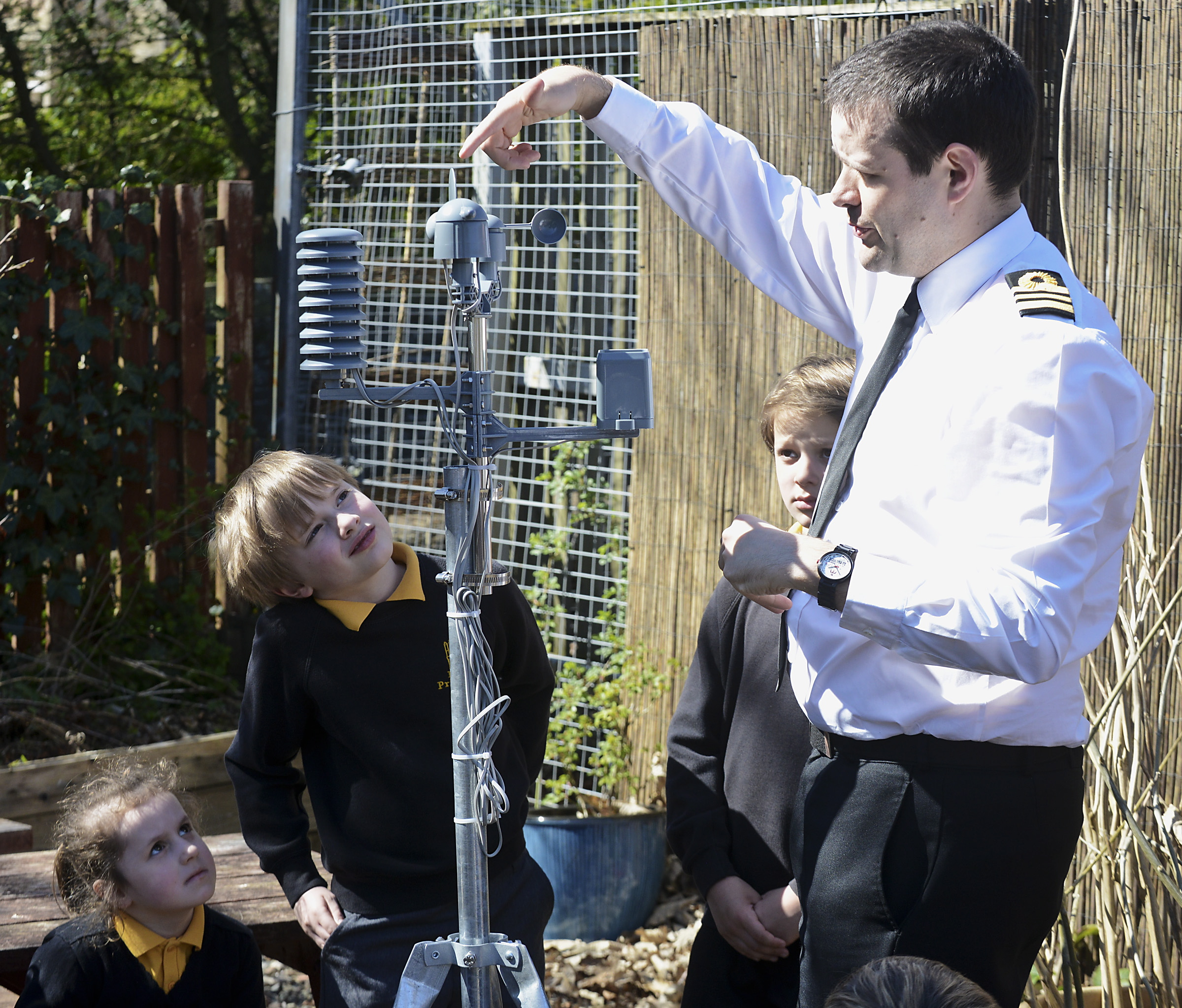 Weather station insalled at Rhu Primary School Lt Cdr Gordon Jones showing children of Rhu primary the weather station to be installed on the roof of the primary school. Consent forms held for all children by photographer.