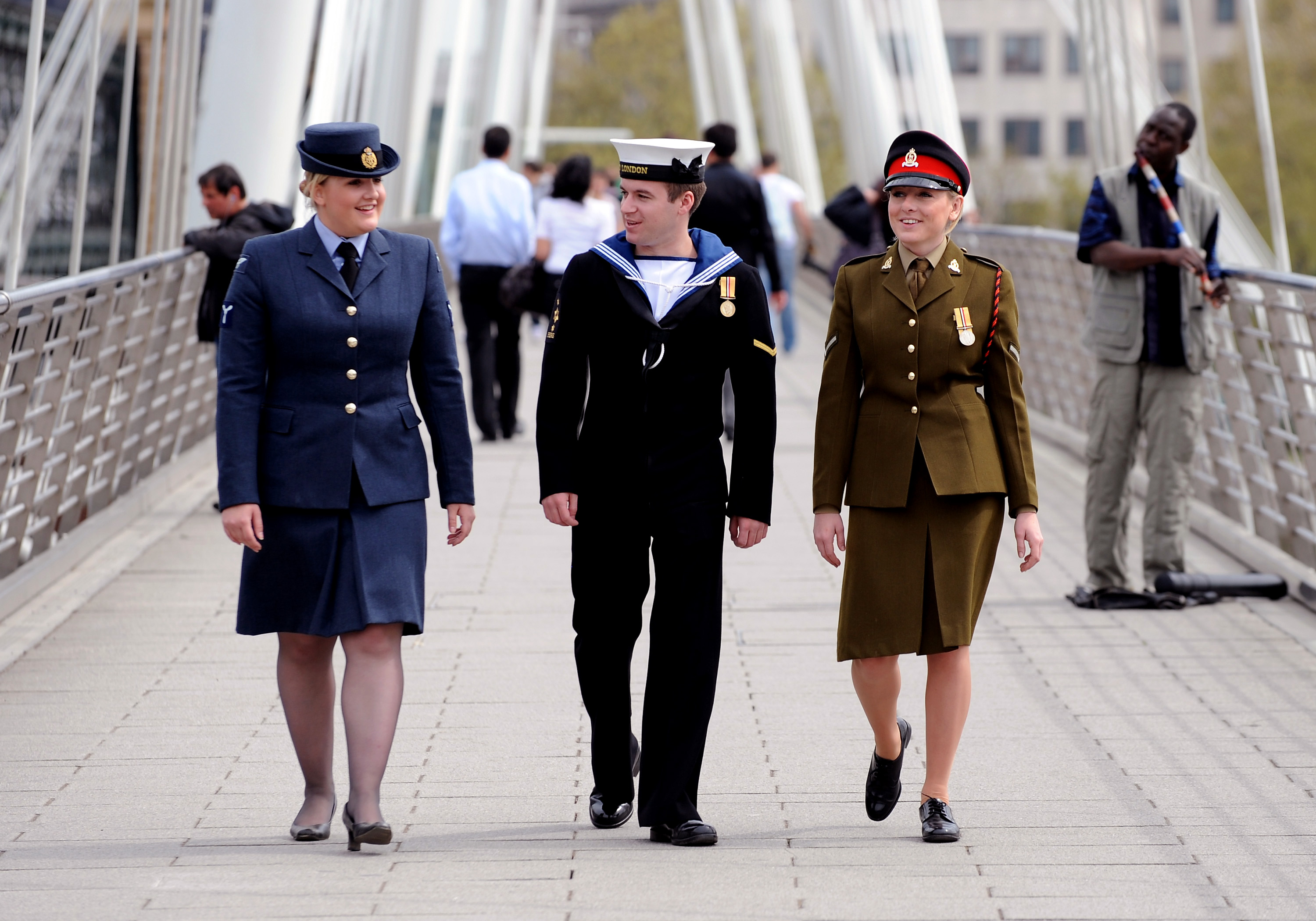 From left, a Royal Air Force servicewoman, a Royal Navy sailor and an Army soldier stroll through London prior to Armed Forces Day 1010.  This image is fully model released.