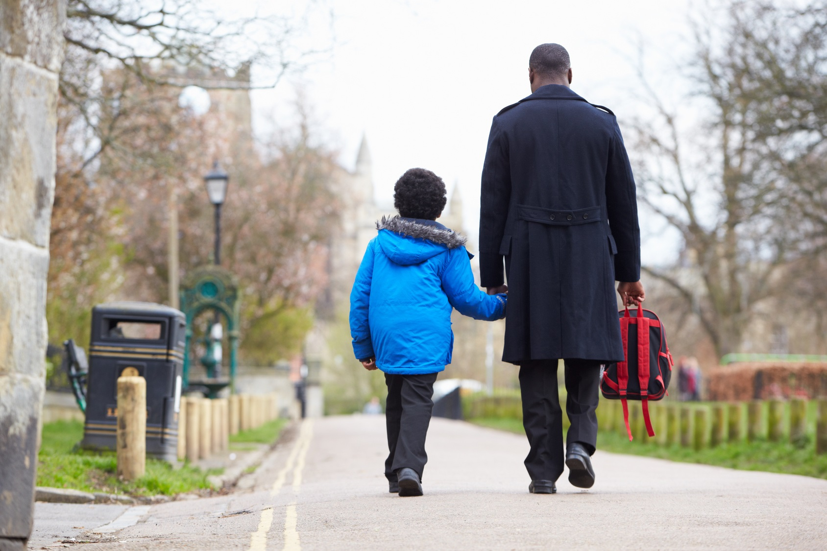 Father Walking Son To School Along Path
